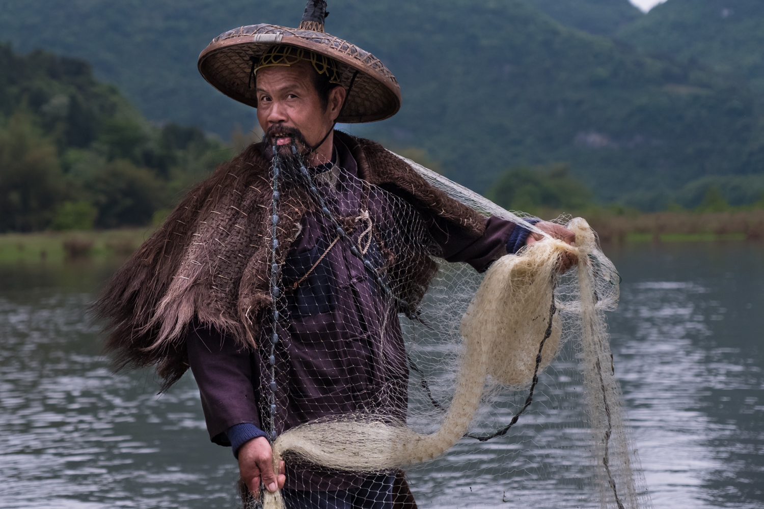 Mr. Hong prepares the fishing net